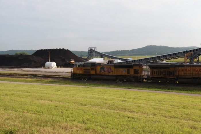 Coal being unloaded from a train to be transferred to barges on the Mississippi river.
