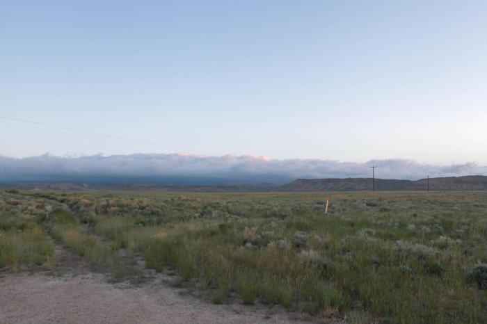 The clouds held back by the mountains during Sunrise. -- Lamont, WY