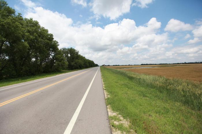 Straight roads, puffy clouds, light traffic, and a tail wind. Now this I could get used to. -- Near Hutchinson, KS