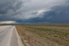 We're headed North, and the clouds overhead are headed East. We set out just after the storm had passed us by and zipped along the tail end of the front. Didn't get wet at all. --Sweetwater Station, WY