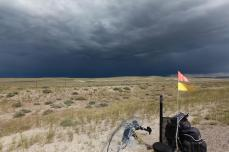 Looking at the West-end of an Eastbound thunderstorm. (Much better than looking at the West-end of an Eastbound goat!) --Sweetwater Station, WY (Persephone has her flag pole back, now improved with two flags)