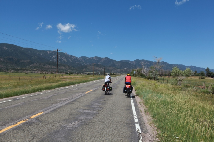Paul and Terry cycling steadily towards the front range of the Rockies