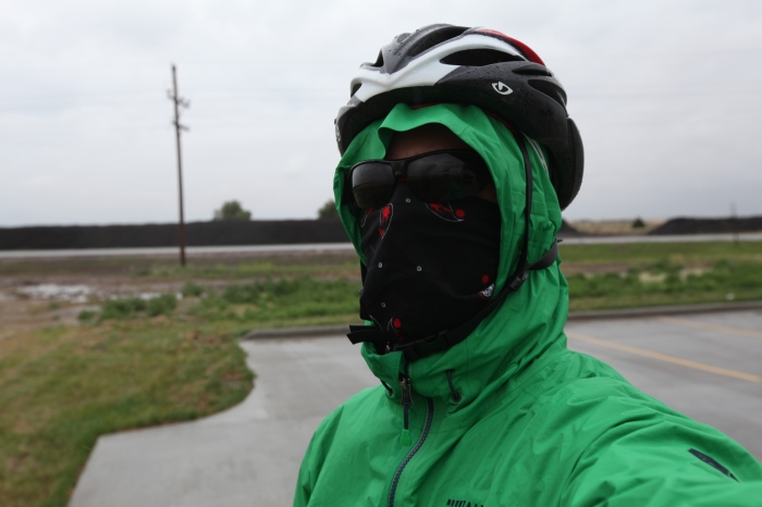 Geared up against the wind and rain.