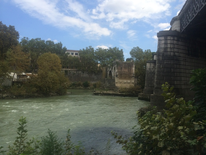 "New bridge and old bridge.  Just South of Tiber Island in Rome. The ""old"" bridge is relatively new by Rome standards only a handful of centuries."